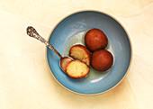 Gulab Jamun (Deep fried dough balls in syrup, India)