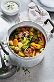 Winter savoy cabbage and carrot stew with meatballs