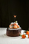 Chocolate cake, decorate with tangerines