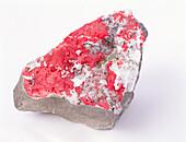 Cinnabar on calcite rock groundmass
