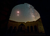 Lunar eclipse, Milky Way and Mars over a caravanserai, Iran
