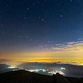 Ursa Major and North star over city lights