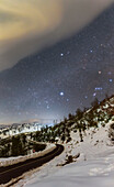 Winter constellation over snow-covered Mountains
