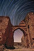 Star trails over a caravanserai, Iran