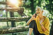 Active senior woman taking a workout break