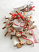 Christmas wreath made of gingerbread biscuits and cinnamon sticks