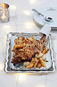 Leg of lamb with pears and onions