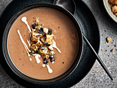 Chestnut soup with croutons and red watercress