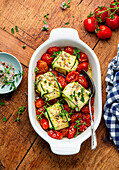 Zucchini fish parcels with tomatoes