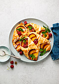 Peach puff pastry with raspberries