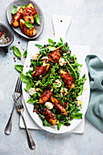 Summer salad with nectarines wrapped in Parma ham and mozzarella cheese