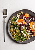 Autumn salad with beetroot, sweet potato, spinach and feta