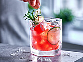 Watermelon punch with cucumber and rosemary
