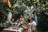 Friends having meal in garden