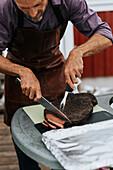 Man cutting meat
