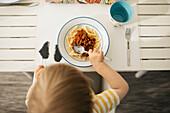 Toddler having pasta meal