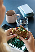 Womans hands holding sandwich