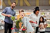 Family doing shopping in supermarket