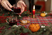 Womans hands holding glass with glogg