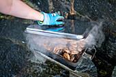 Preparing prawns on grill