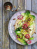 Grilled lettuce with marinated onions and almond cream