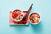 Strawberry yoghurt with oat flakes and pistachios