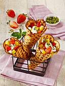 Waffle cones filled with fruit, mascarpone and pistachio nuts