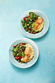 Salmon with potato-celery puree and spinach salad