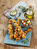 Grilled dough skewers with bacon and garlic