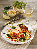 Spicy marinated grilled Jamaican chicken with vegetable rice