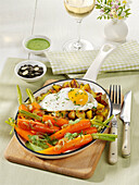 Carrots with fried potatoes and fried egg