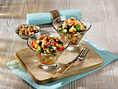 Fruity broccoli couscous salad with blueberries, nuts and feta cheese