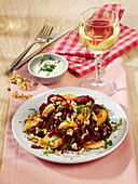 Salad with beetroot noodles, chicken breast and goat's cheese