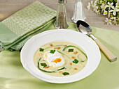 Potato-and-garlic soup with poached eggs