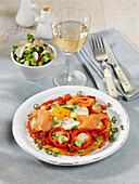 Potato pizza with peppers, salmon, mozzarella and parmesan cheese
