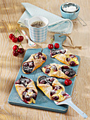 Cherry-and-poppyseed pastries with vanilla pudding