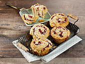 Croissant muffins with blackberry jam and almonds