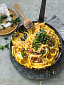 Macaroni with pancetta, pine nuts and cheese sauce