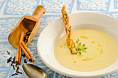 Cream of wine soup with poppy seed pastry sticks