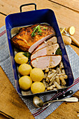 Dijon Pork roast with poppy seed black salsify and dumplings