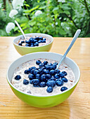 Muesli with blueberries on outdoor table