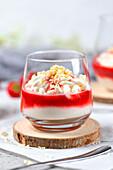 Spaghetti ice cream with mascarpone and strawberry sauce