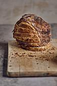 Freshly sliced sourdough bread on a wooden cutting board