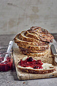 Slice of bread with butter and rhubarb and wild berry jam