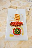 Halloumi skewers with a herb pesto and tomato bruschetta