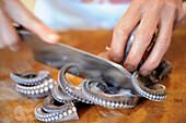 An octopus being sliced