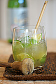 Sakerinha made with lime, raw cane sugar and sake