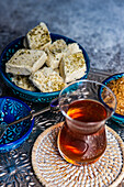 Turkish tea and dessert halva served in traditional style