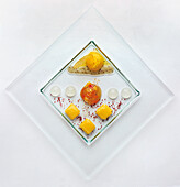 Gin and tonic jelly with lime-saffron sorbet and mango ravioli