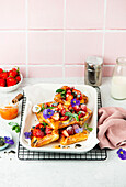 Danish puff pastry with strawberries and edible flowers